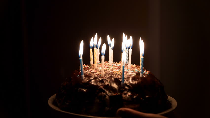 Tasty Birthday Cupcake With Candle On Grey Background