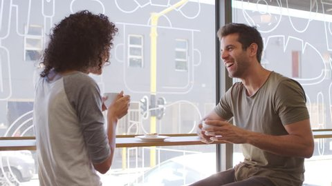 Couple Meeting For Date In Coffee Shop Shot In Slow Motion