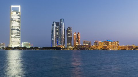 Abu Dhabi. Etihad Towers and Emirates Palace hotel time lapse viewed from the Breakwater, Abu Dhabi, United Arab Emirates, Middle East
