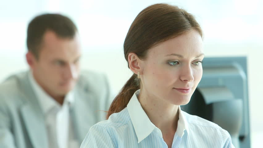 Tilt up of an office girl concentrated on her work | Shutterstock HD Video #2755772