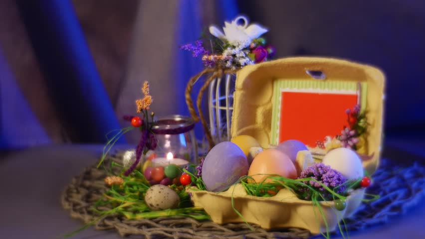 Camera moves over the easter eggs and candles stock footage video opolepoland feb 19 2017 splendid composition from easter hen and quail eggs negle Image collections