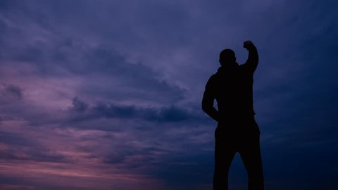 Strong man raises arm for victory