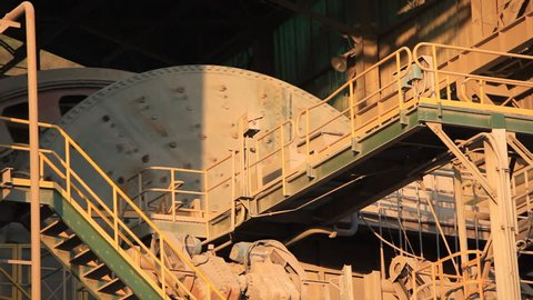 A ball Mill inside of a copper processing industry. A ball mill, a type of grinder, is a cylindrical device used in grinding (or mixing) materials