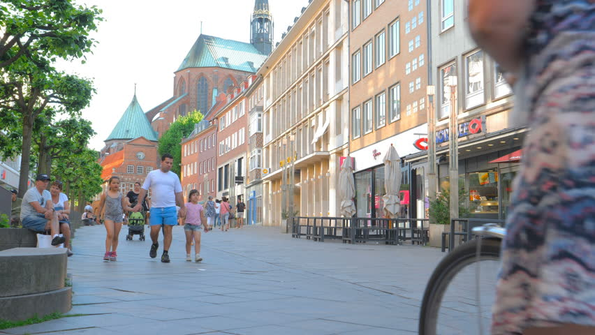 LUBECK, GERMANY - MAY 28: People walking on pedestrianized street on May 28, 2017 in Lubeck, Germany.