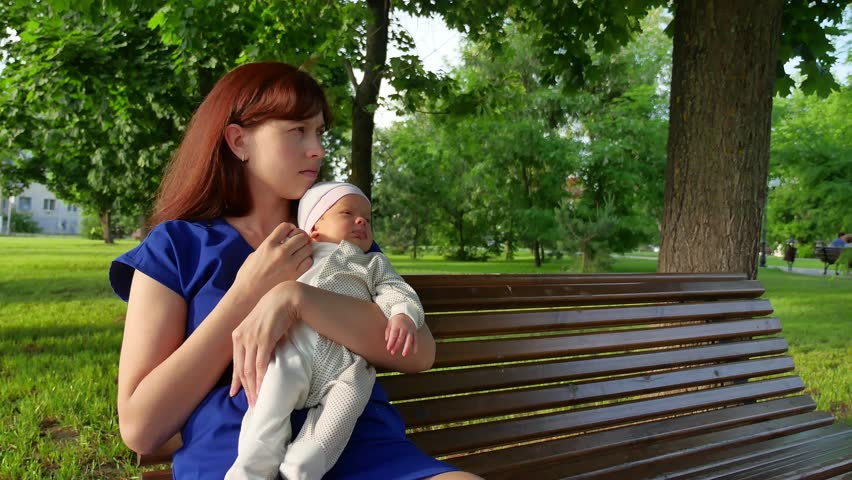 4e234398aa64 Mother Sitting with Baby On Stock Footage Video (100% Royalty-free ...