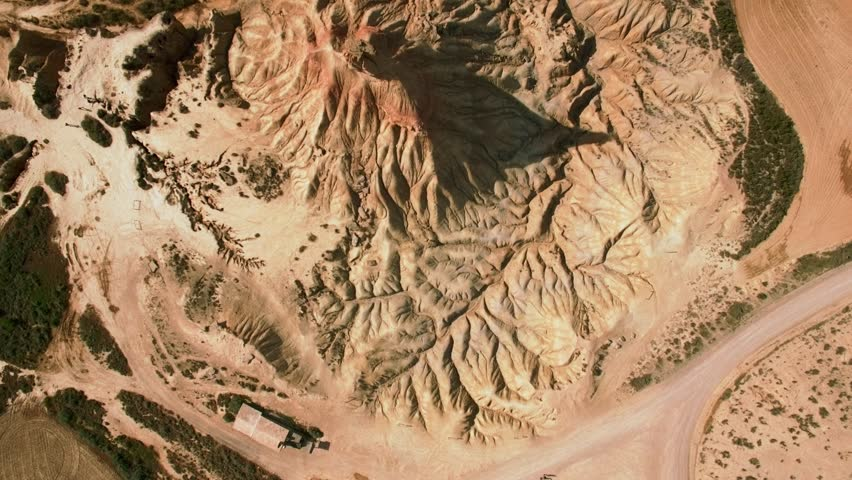 Top view drone footage flying over high peak in national reserve park dry and beige desert, erosian made geological mountain pillar, drought resulted landscape, global warming threat #27682762