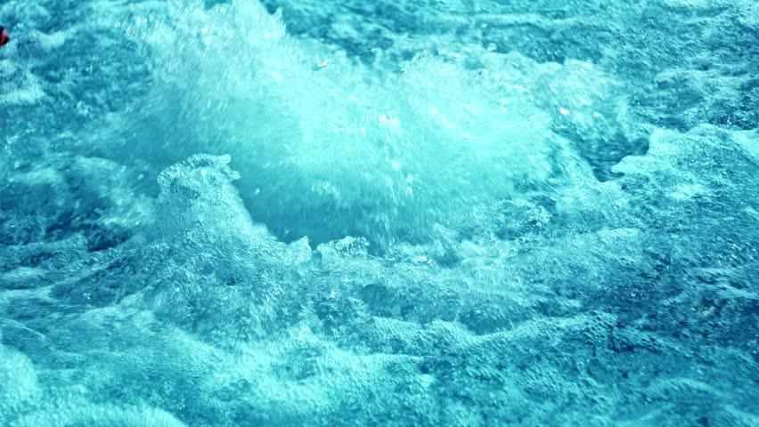 Pool Water Splash water splashes in jacuzzi. rippled water in blue swimming pool
