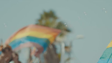Slow motion shot of the pride flag waving in the wind