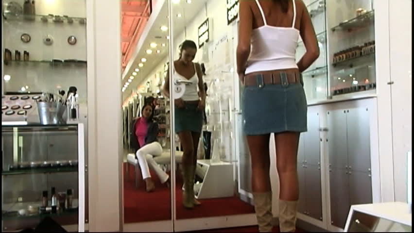 Woman Trying On A Denim Skirt