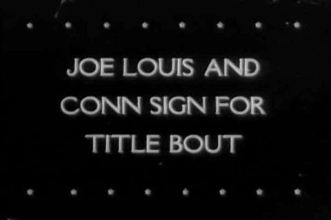1940s: Professional boxers, Joe Louis, and Billy Conn weigh in, and sign contracts for their upcoming title bout in front of the athletic commissioner in 1946 in NYC.
