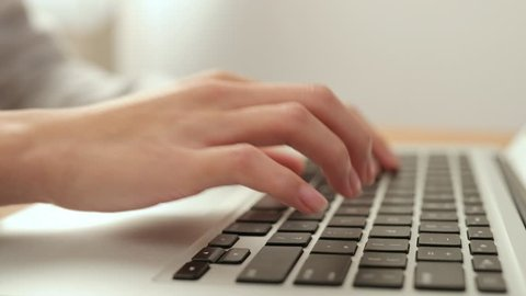 Woman using on notebook computer at home