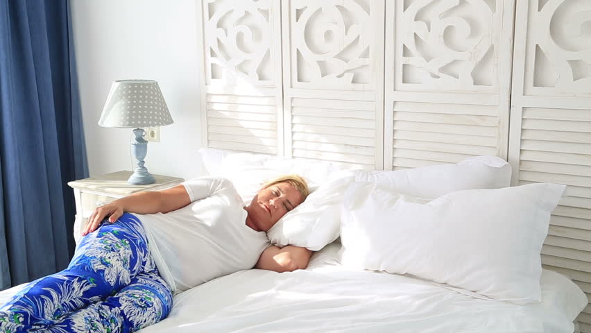 blonde woman sleeping on her bed hd stock footage clip