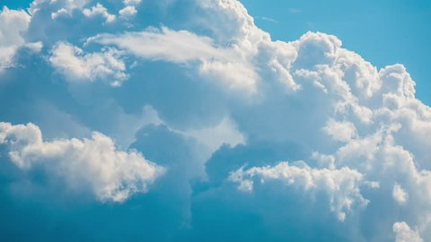 Blue sky fast motion time lapse video of close up view of white fluffy, puffy cumulus clouds flying, passing, moving high above the earth at airplanes flights height, beautiful nature background 4K