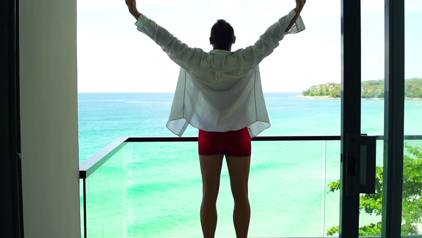 Man in underwear stretching arms and admire exotic view on terrace, super slow motion 240fps  | Shutterstock HD Video #27877072