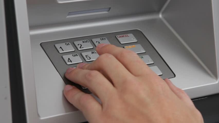 Using keypad at money machine