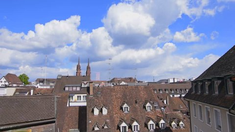Timelapse view over houses and buildings in Basel, Switzerland. In the background the Minster of Basel.