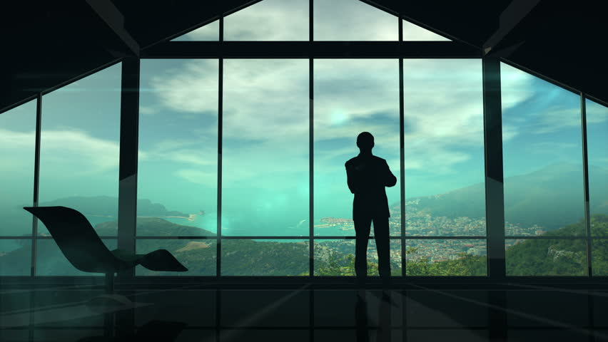 A man is standing by the window viewing IOT infographics elements   Shutterstock HD Video #27905881