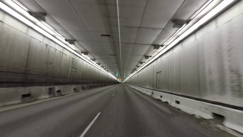 DILLON, COLORADO - 2 JUN 2017: Colorado Eisenhower Tunnel inside drive POV fast motion.  Memorial Tunnel on I-70 crosses under the continental divide in the Rocky Mountains of Colorado. Point of view.