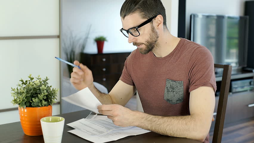 Handsome man finish checking papers and going somewhere, steadycam shot  | Shutterstock HD Video #27929452