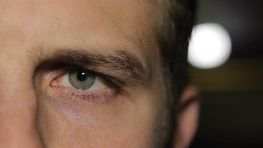 Single eye in dark lighting