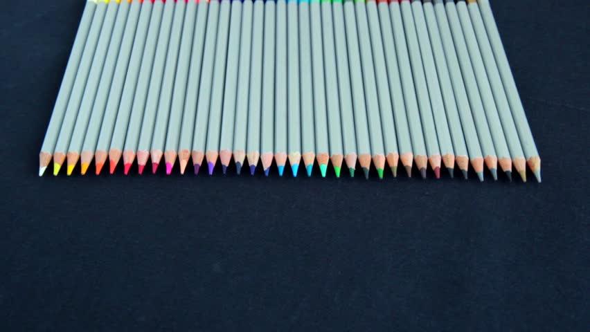 Colored pencils. many color pencils on black background. color pencils wallpaper.   | Shutterstock HD Video #28016431