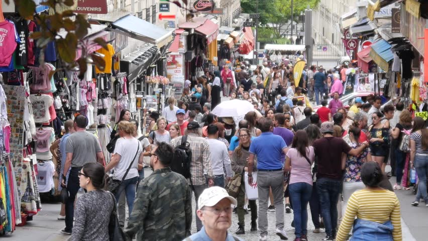 PARIS, FRANCE - MAY 22, 2017: Montmartre Most Crowded Street People Tourists Walking Along Souvenir Shops