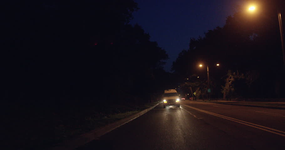 Van driving on a dark street at night in an urban city, in slow motion | Shutterstock HD Video #28026862