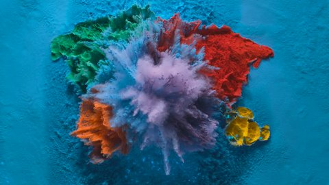 World map made out of colorful powder/particles fly after being exploded. Shot with high speed camera, phantom flex 4K. Slow Motion.