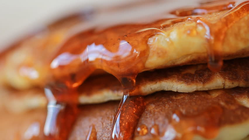 Food Pancake Maple syrup pouring onto stack of pancakes. Making Pumpkin Pancakes on Frying Pan. Homemade Griddle Cakes | Shutterstock HD Video #28092952
