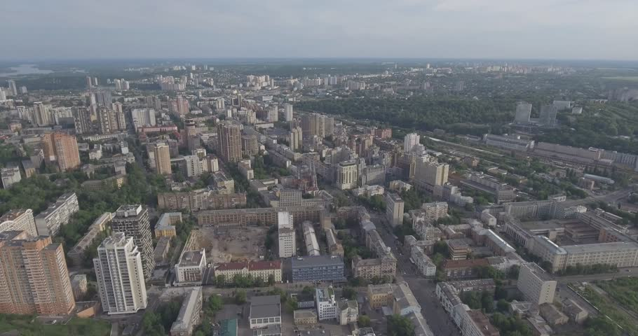 Kyiv city city landscape. City landscape from a bird's eye view. Urban infastructure from the top. Flight over the city. Summer, sunny day. Cars, people walk on the sidewalk, the architecture.   | Shutterstock HD Video #28099012