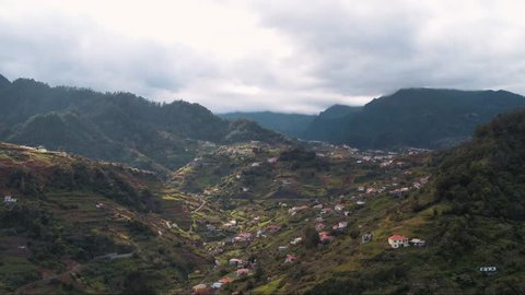 Aerial view of small village in a valley on Madeira (Portugal) by drone