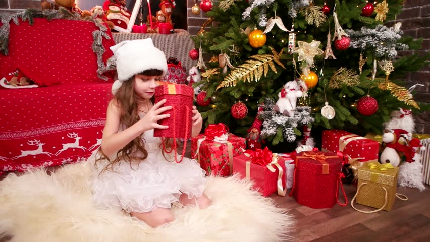 Toys Under Christmas Tree : Santa claus puts gifts and toys under christmas tree stock