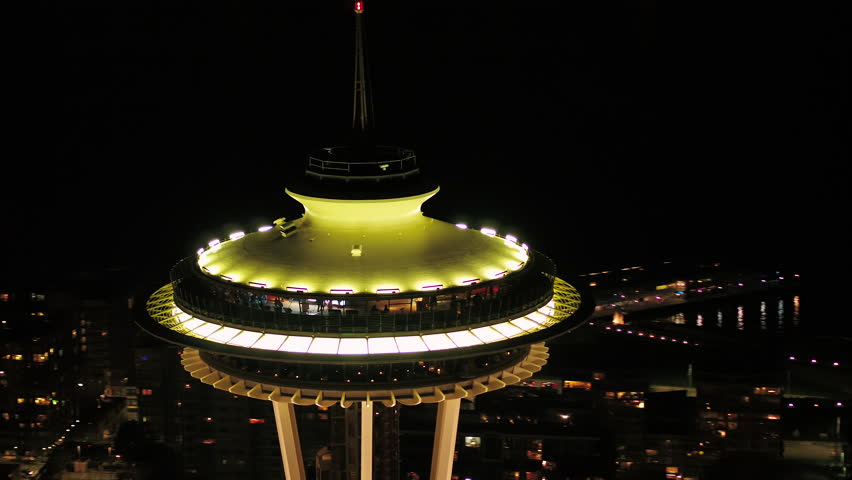 Seattle Aerial v106 Closeup shot flying around Space Needle at night with cityscape views 4/17