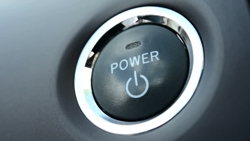 Pushing a power button in modern car