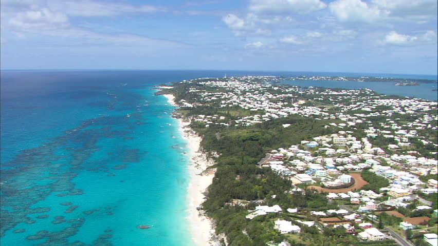 Aerial flight over the beach shoreline of Southlands, Bermuda.
