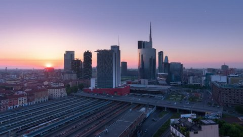 milan city timelapse sun rising over financial district