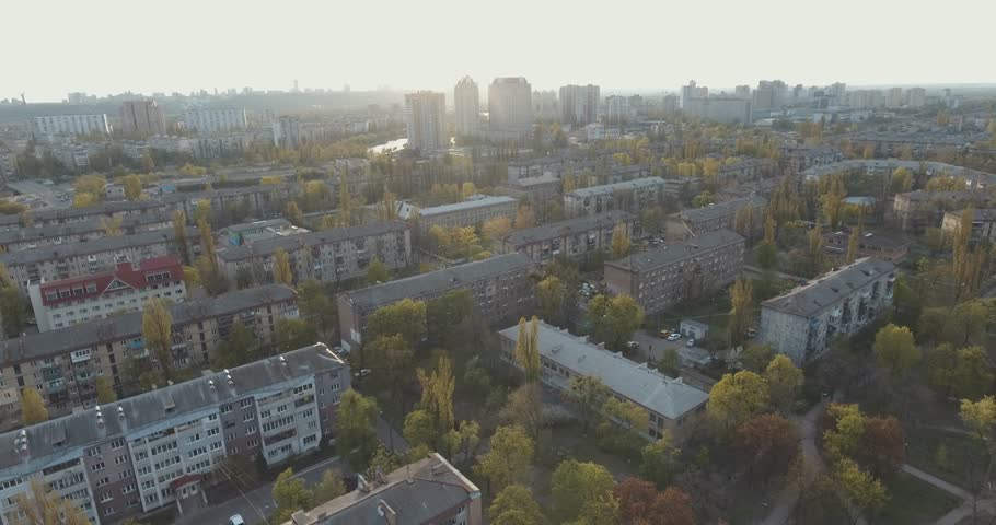 Residential area of ??the city at sunset, aerial. Cityscape, Parks and squares from a height. Summer evening, apartment houses, green trees. Dnepr River. Trails with cars. People rest in the park.  | Shutterstock HD Video #28208422