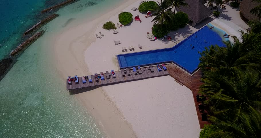 v06748 Aerial flying drone view of Maldives white sandy beach swimming pool in luxury 5 star resort hotel relaxing holiday vacation on sunny tropical paradise island with aqua blue sky sea ocean 4k #28265185