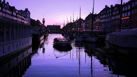 4K Ship traffic at Nyhavn canal on May 5, 2017 in Copenhagen, Denmark.