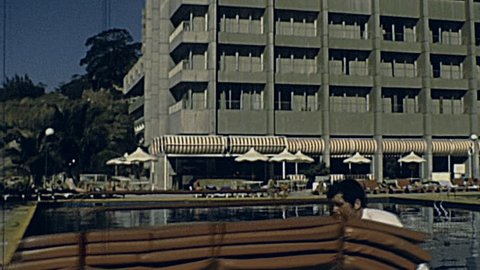 BRAZIL - 1981: man work in front of the swimming pool of the hotel in 1981 in Brazil