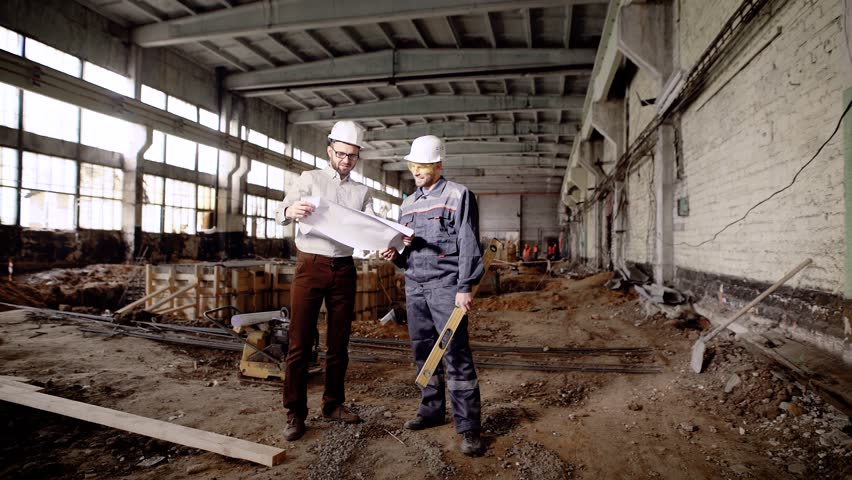 Supervisor and manager discussing project. Two men in hard hats standing in destroyed building and discussing project plan. | Shutterstock HD Video #28289308