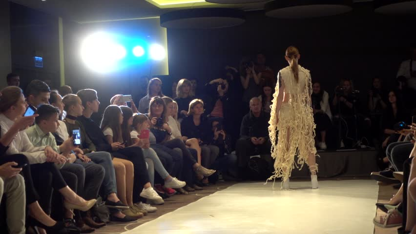 FASHION LABORATORY - ART SCHOOL EXAM OF SECOND COURSE STUDENT - KRAKOW, POLAND - JUNE 10, 2017: Young Girl Model Catwalk on a Podium - Fashion Bright Show  | Shutterstock HD Video #28324156