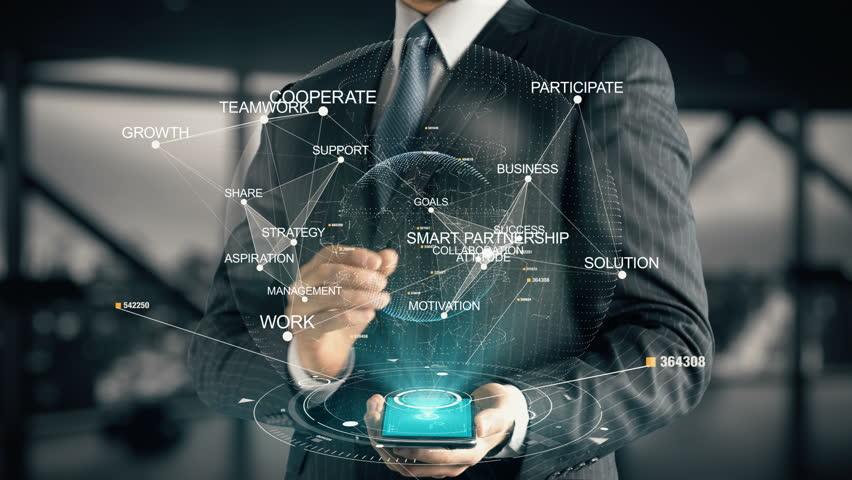 Businessman with Smart Partnership hologram concept   Shutterstock HD Video #28335952
