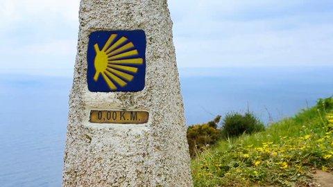Cape Finisterre ( Cabo Finisterre ) pointer final destination for pilgrims Camino de Santiago  . Finish zero Kilometers. buen camino peregrino. video footage