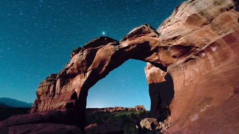 dawn breaking over rock arches