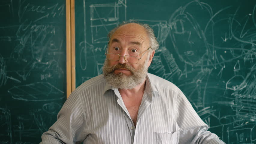 A charismatic old teacher explaining and shouting near the blackboard 4K