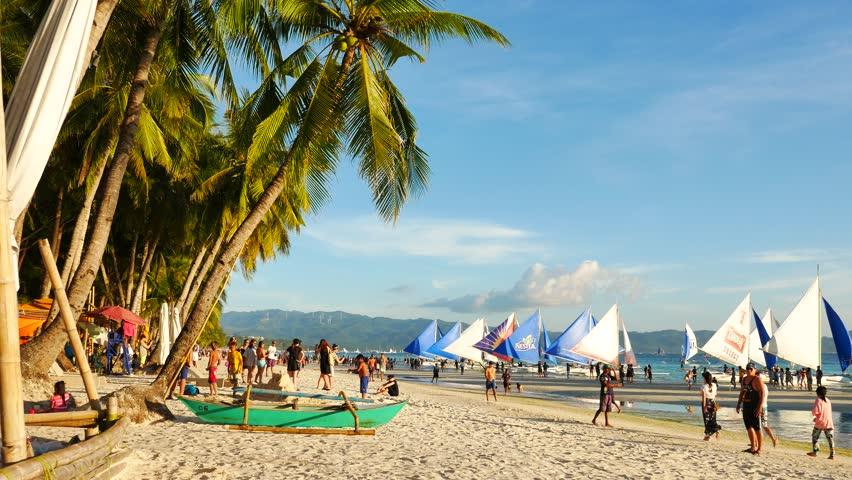 Aklan, Boracay island, White beach, Philippines – April 9, 2017: UHD evening view of White Beach in Boracay island. Boracay island is famous as one of the world's best tourist destinations.