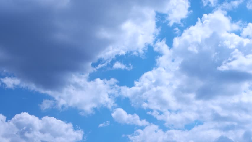 White clouds run against the blue summer sky #28439572