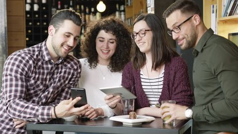Trendy Coworkers Smiling Pretty Friends Looking At Tablet Laughing At Funny Video Meme Online Business Concept Technology Slow Motion Shot On Red Epic 8K