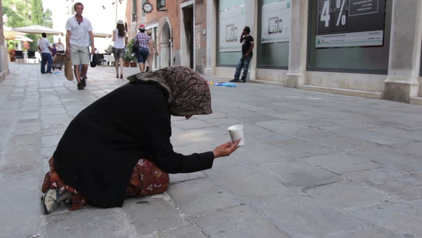 VENICE, ITALY - JULY 1: Woman in streets of Venice asking for money on July 1, 2012 in Venice, Italy.